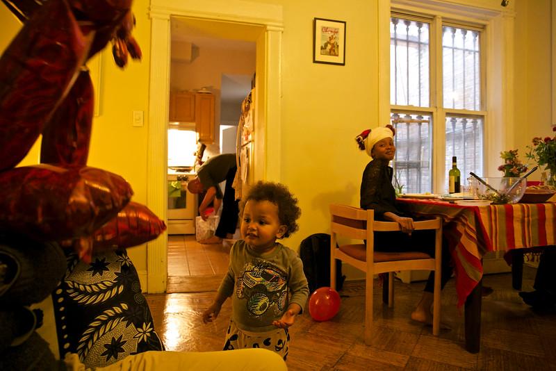 Baye admires his birthday Elmo balloon.