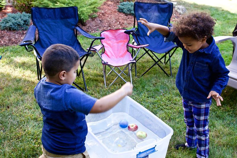Mason and Baye had their own version of apple-bobbing.