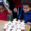 Michaela looks just as excited as Baye when the cupcakes arrive.