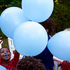 Schoolmate Michaela reaches for one of the balloons.