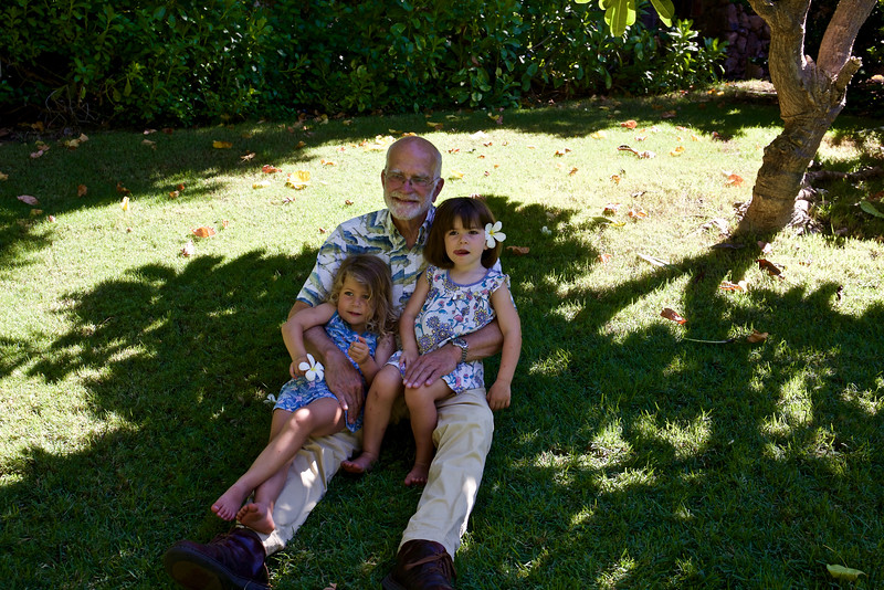 Steve, Clio, and Anahita with plumerias