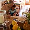 Jason helps Baye write his first postcard at the beach house.