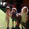 The triplets ( Anahita, Makeda, and Clio) were enamored with Mousse, Sarah and Randy's Labradoodle.  He was very patient.