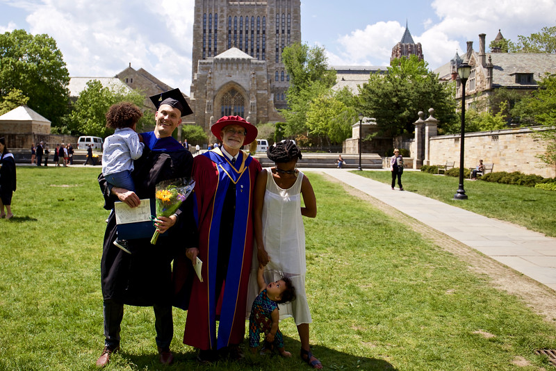 A beautiful moment, on a beautiful spring day: Jason held Baye, Steve and Lu with Masha. This is Yale's Cross-Campus, in front of Sterling Memorial Library.