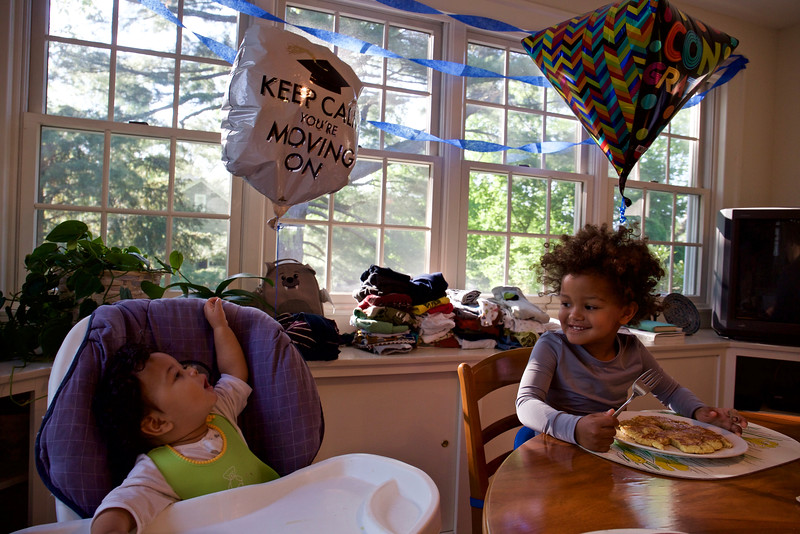 At home in Hamden, Masha and Baye enjoy the balloons--and the pancakes.