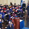On stage at Woolsey Hall, Jason marches up to accept his Ph.D. diploma.
