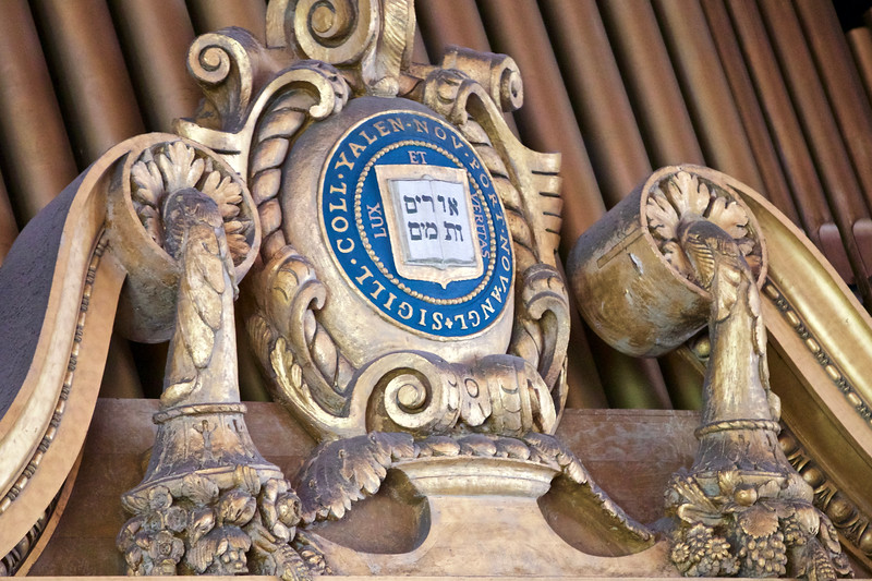 "Yale crest above the Newberry Memorial Organ with  the university's motto: ""Lux et Veritas."" The organ, built in 1901,  played a powerful processional march for the commencement ceremony."
