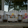 On the front porch in Adirondack chairs:  Makeda, Clio and Anahita.