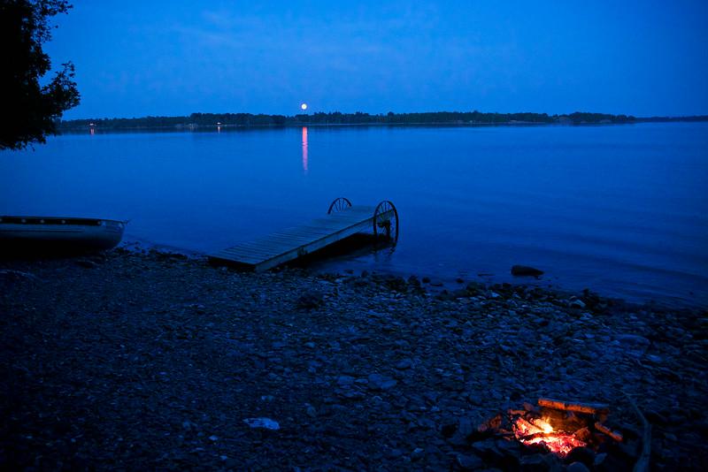 moonrise and a bonfire's coals glowing