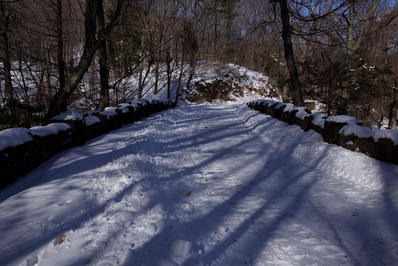 Shadows falling on winter snowfall.