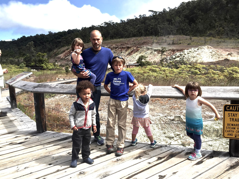 Justin with the children at the sulphur springs near the volcano.
