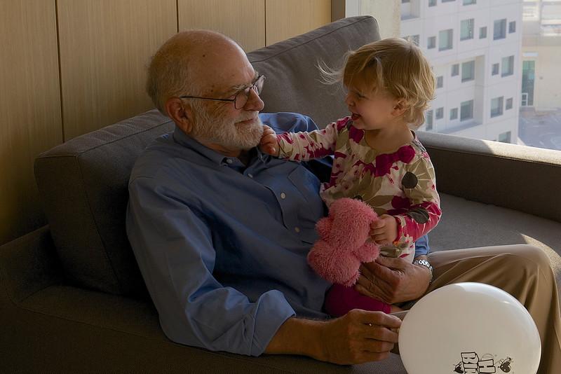Grandpa delights Clio.