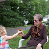 Clio hands Lorene a freshly picked marigold.  Lorene made the trip up from Washington, D.C. to see Justin and the children.