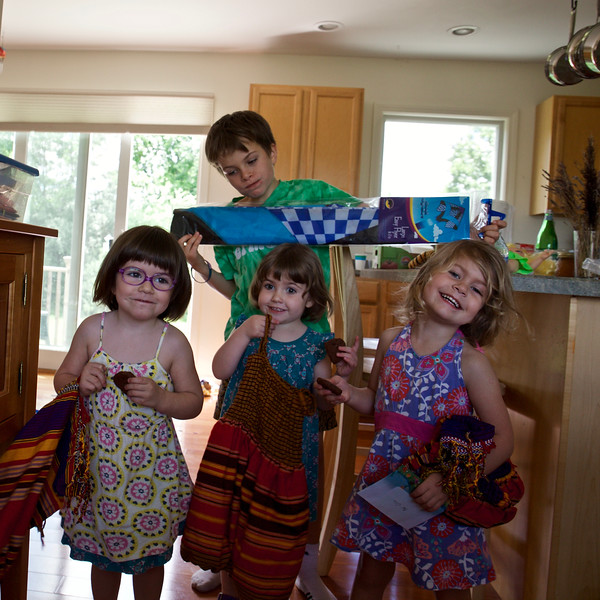 The children excitedly opened presents from Uncle Jason and Aunt Lu.  Taio has a kite; the girls received dresses from Ethiopia.