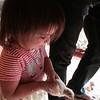 Anahita bravely holds a baby white turkey.