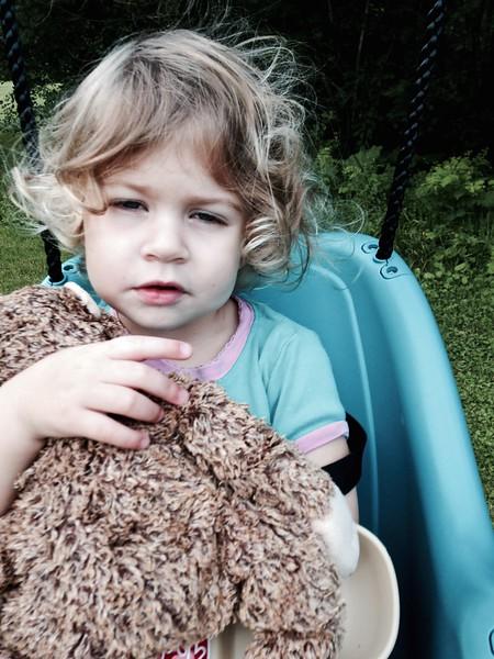 Clio sleepily holds her monkey.