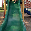 Anahita and Makeda on the slide at the playground.