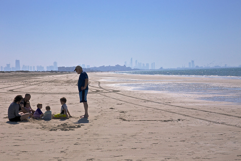 On the beach of Saadiayat Island, with Abu Dhabi in background.