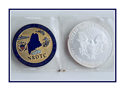 Michael's NROTC coin and a brand new silver dollar.  Michael presented the silver dollar to the first enlisted sailor who saluted him, per Navy tradition.