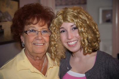 Meghan trying on a wig that Dolly got, enough to say, Meghan keep your straight dark hair, lol!