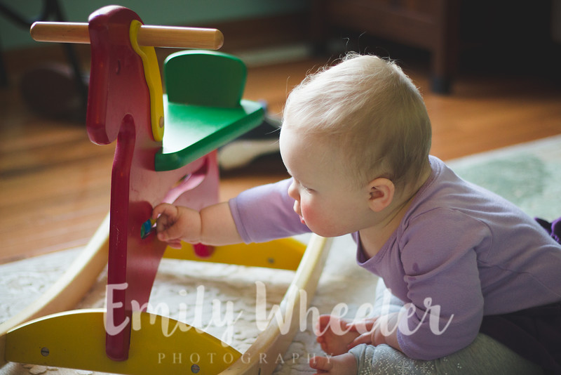Day 58 | February 27th<br /> Playing with her rocking horse. She sits on it with one leg down so she can rock!