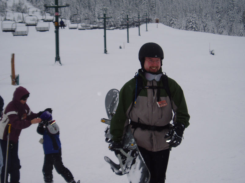 Uncle Kevin tries snowboarding.
