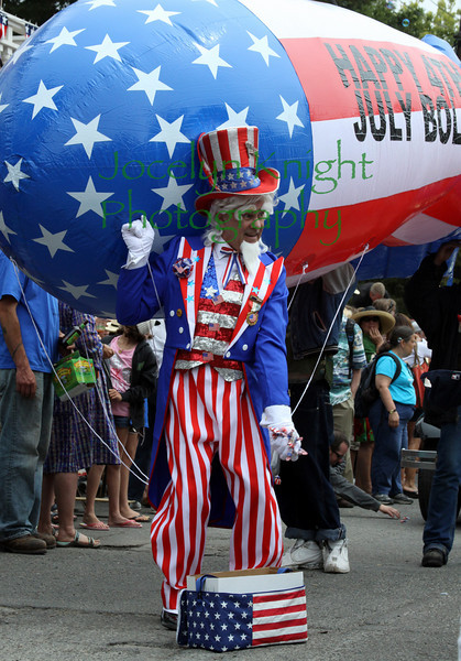 """""""Uncle Sam"""" grabs a handful of candy to toss to the crowd at the Bolinas 4th of July Parade in Bolinas, CA, on July 4, 2010.(Special to the IJ/Jocelyn Knight)"""