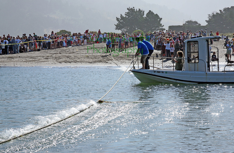 Looking east toward  the Stinson Beach side, the Tug of War rope gets placed into position for the Women's Pull Sunday morning, July 4, 2010 at the inlet between Bolinas and Stinson Beach on the California coast.The Bolinas women won after a strenuous 9 minutes of hard pulling on the heavy wet rope.(Special to the IJ/Jocelyn Knight)