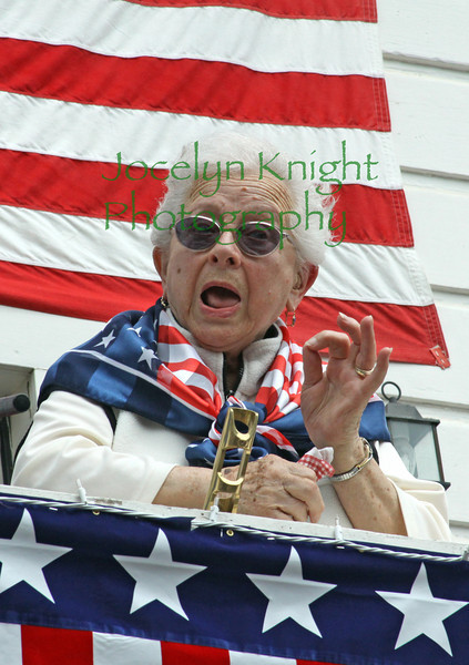 Annie Crotts sang the Star Spangled Banner for the 47th year from the deck above Smiley's Saloon in downtown Bolinas, CA and then congratulated the crowd on their singing at the Bolinas Parade on July 4th, 2010.(Special to the IJ/Jocelyn Knight)