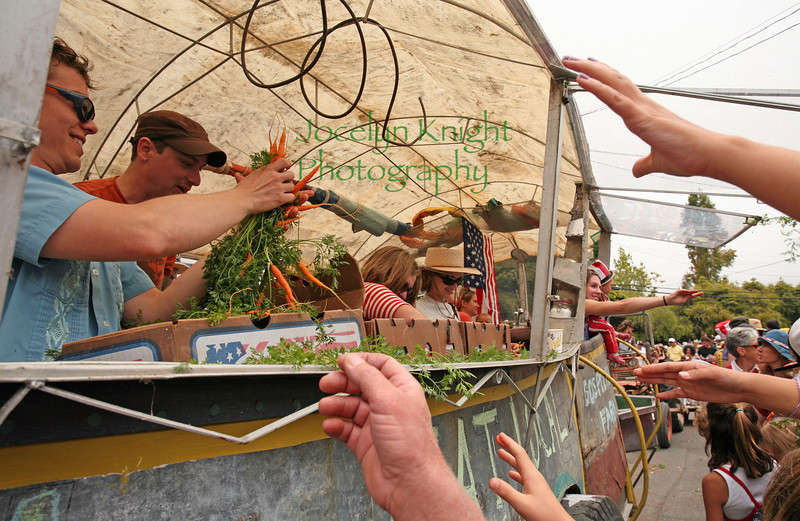 Gospel Flats Farm tossed organic baby carrots from their rolling kitchen float to the hungry crowd at the Bolinas Parade on July 4, 2010 in downtown Bolinas, CA.(Special to the IJ/Jocelyn Knight)