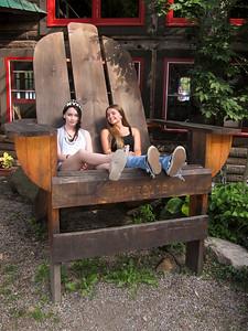 Alaina and Gracie the big Adirondack chair at Timberlock.