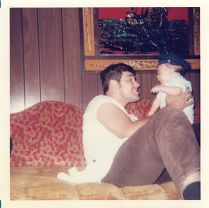 1972_dad_holding_aaron_funny
