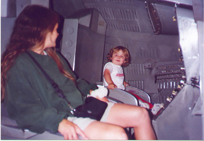 Kayla and Kris inside of a replica Gemini space capsule at the Pacific Science Center.  Seattle WA August 1999