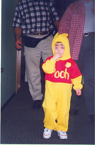 Kayla goes trick or treating with Grandma Susan and Grandpa Hal.  October 1999