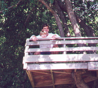Kayla and her father sitting in the treehouse at the Doe Bay Resort.  Olga, Orcas Island WA July 1999