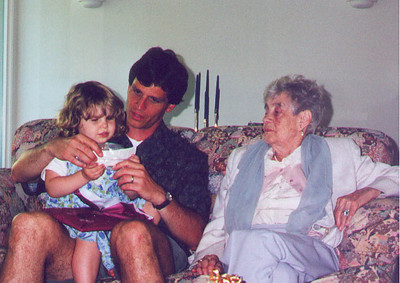 Kayla and Paul open up a birthday present, while Kayla's Great Aunt Claire looks on. Palo Alto CA July 2000