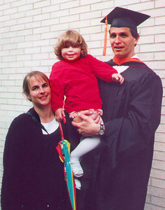 Paul graduated from Seattle University with a Masters in Software Engineering in September, but walked with his fellow graduates in the June ceremony.  Kayla, Kris, and Paul's parents were on hand to celebrate.  Seattle WA June 2000