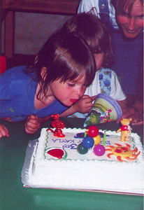 Kayla's good friend Lauren Valenti shows her how to blow out the candles, Kirkland WA June 2000