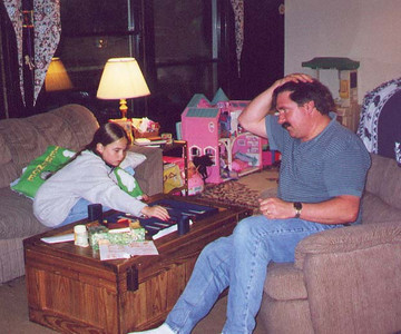 It looks like Brittany is beating her dad at backgammon.  Brookfield CT, June 2000