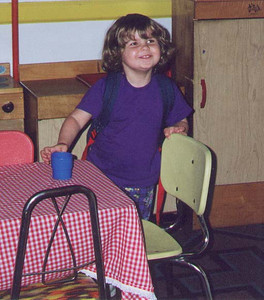 Kayla plays in the kitchen of the school below Uncle Rudy's church.  Croton-on-Hudson NY, June 2000