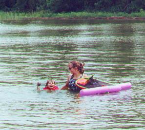 Kris and Kayla take a dip in Lake Minnetonka.  Spring Park MN August 2000