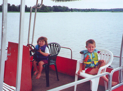Mutiny aboard the pontoon boat.  Chaos ensues as Grandpa Solem tries to take the wheel back.  Birch Island Lake WI August 2000