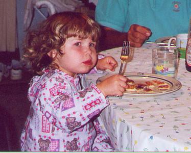 Kayla enjoying a pancake breakfast with Grandma and Grandpa Solem.  Birch Island Lake, WI August 2000
