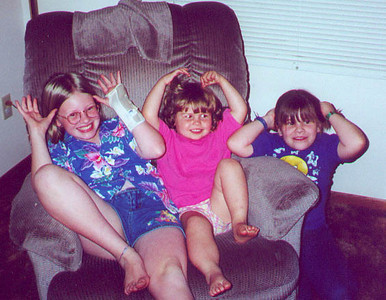 Jennifer, Kayla, and Claire keep us guessing as to whether they're moose or deer.  Blaine MN August 2000