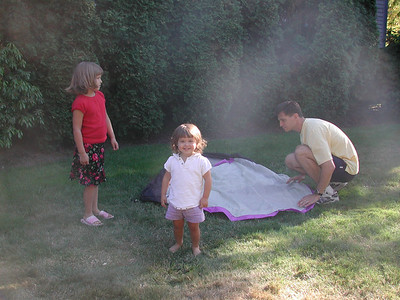 Paul and the girls set up the tent in the backyard, in preparation for Kayla and Paul's trip.