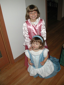 The girls like to play dress-up. And Rachel likes to do things that her big sister does too, even if they don't fit yet.