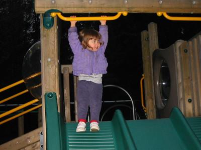Rachel swinging just before hitting the slide.