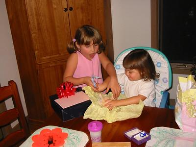Opening up Rachel's presents.