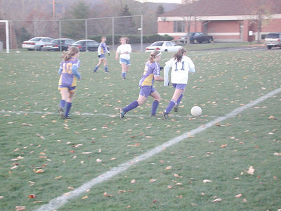 Brittany dribbles up the right side.