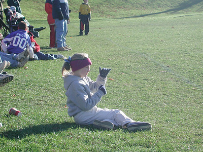 Julia watches from the sidelines.